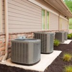 row of heat pumps outside a home